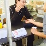 Melbourne acupuncturist / herbalist Dr Rayman Wu in volunteer free consultation